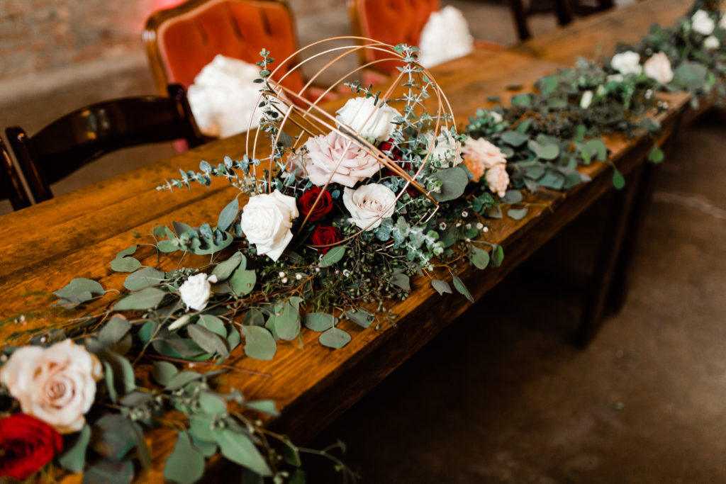 modern floral table decorations at Venue 102