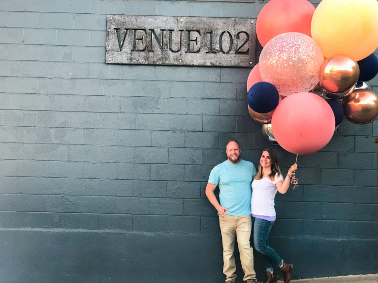 Cy and Andrea Mills in front of Venue 102 Wedding venue okc